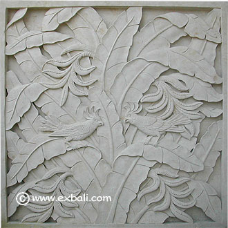 carved stone mural with birds